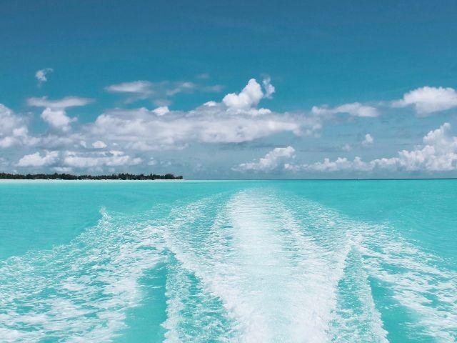 beach-boat-clouds-1170815a
